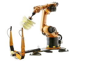 ROBOCHOP by Clemens Weisshaar and Reed Kram: KUKA Model KR60 robot and floor mounted hot wire cutting tool in action.